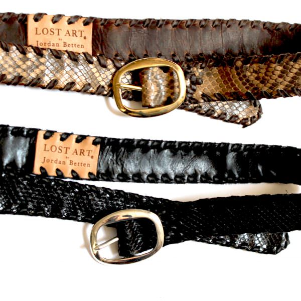 Lost Art Snakeskin Belts in black with a metallic silver buckle and in natural with a brass buckle